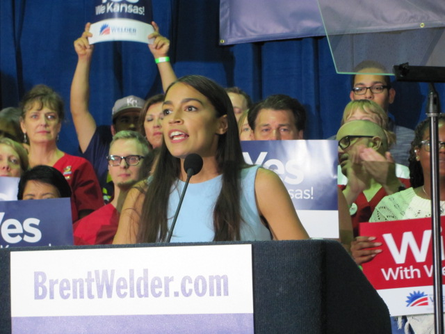 Alexandria Ocasio-Cortez, Congress' youngest member yet, speaking at a rally.