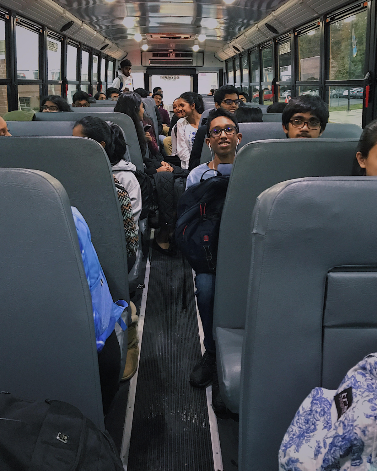 Walking onto bus 970, the hierarchical sectioning becomes apparent with freshman in the front, seniors in the back, and sophomores and junior filling up the middle