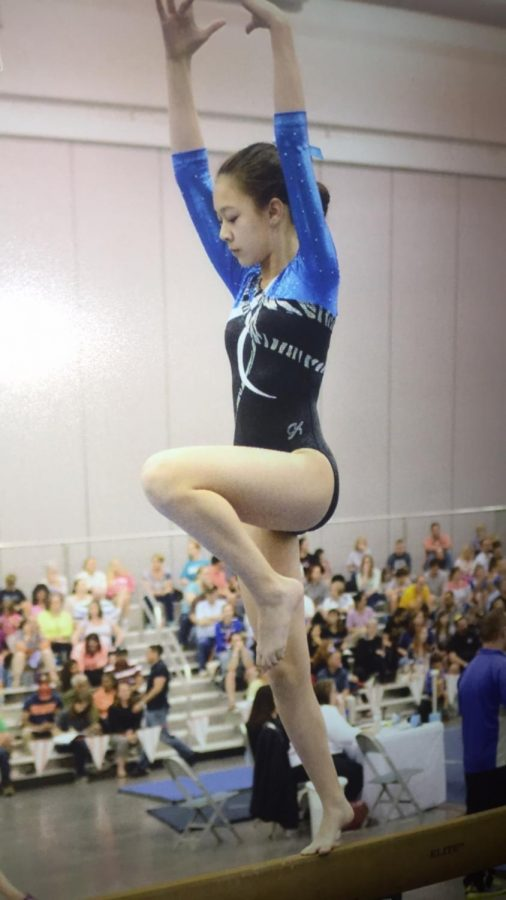 Freshman Alyssa Rask participates in a club gymnastics tournament, but will be making a switch to the TJ gymnastics team this season.