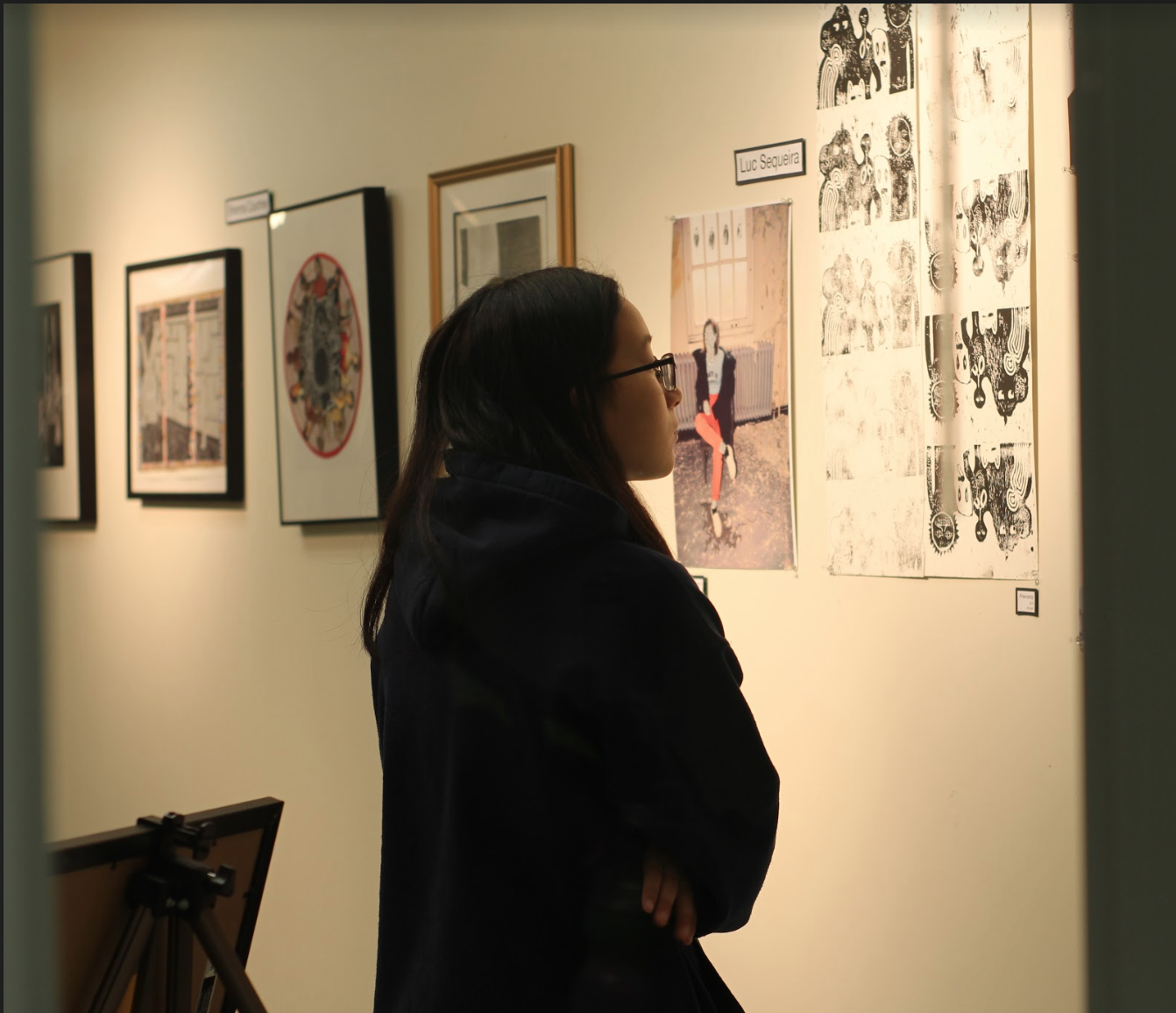 Junior Sophie Uy admiring a block print piece at the Gala