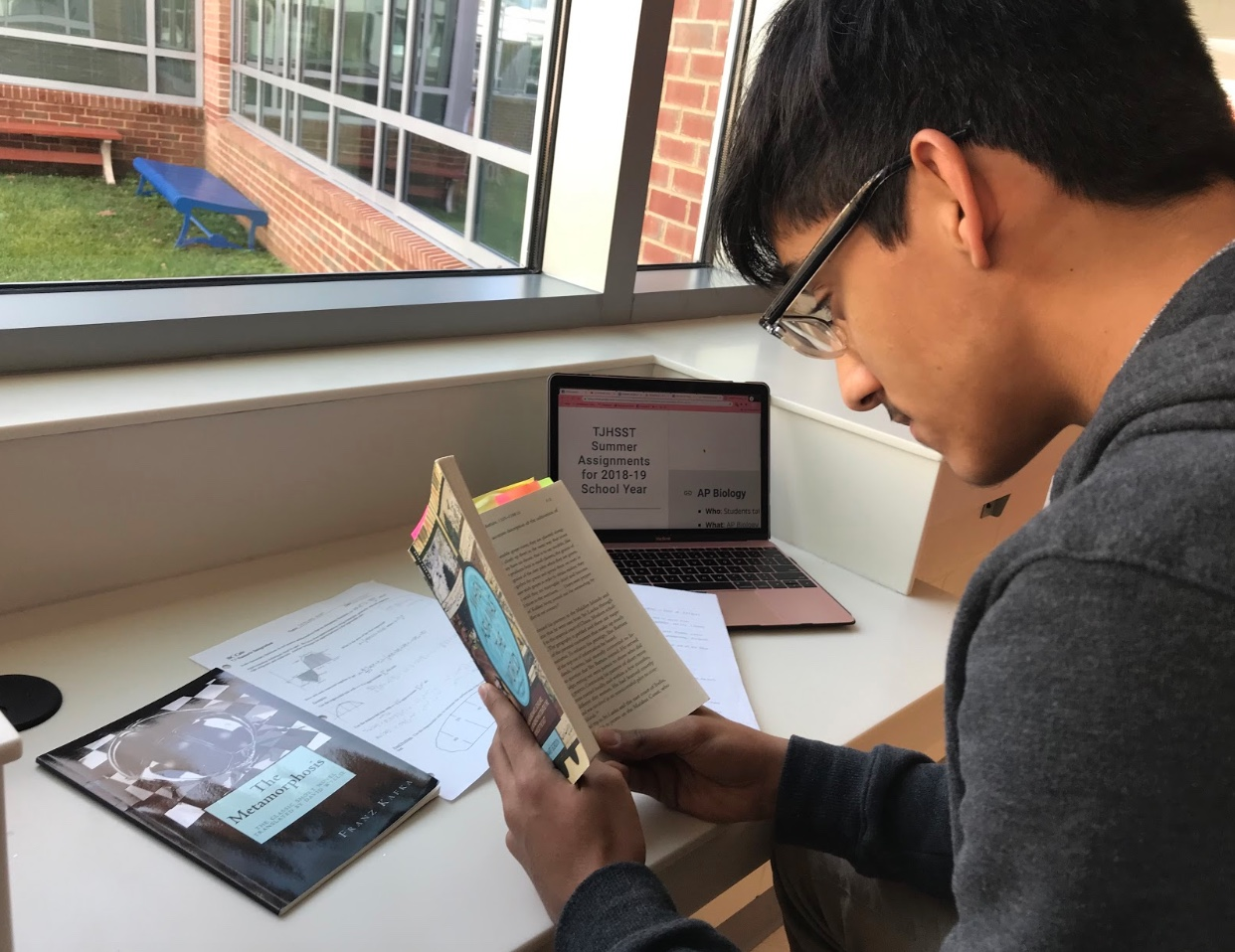 Sophomore Ikhlaas Bhat reads When Asia was the World, a book that was given to read as a summer assignment before the year began.
