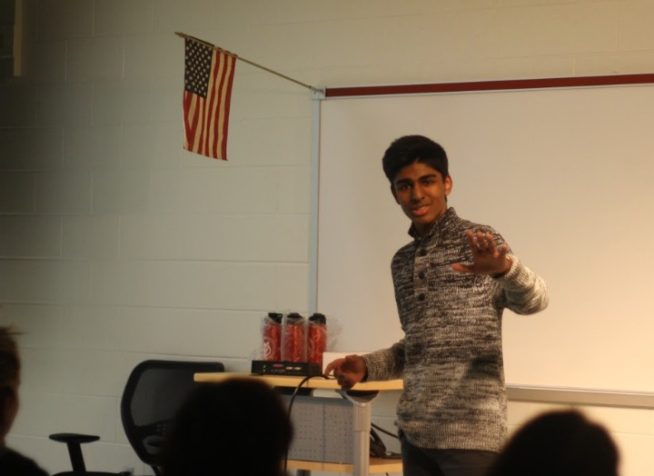 At+the+Poetry+Out+Loud+competition%2C+senior+Yash+Shekar+presents+his+poem%2C+using+a+variety+of+hand+gestures+and+demonstrations+to+bring+the+poem+to+life.