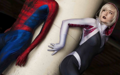 Spider-Man and Spider-Gwen, also known as Spider-Woman, stand side by side ready to take on the world, bringing about diversity as a woman behind the mask.