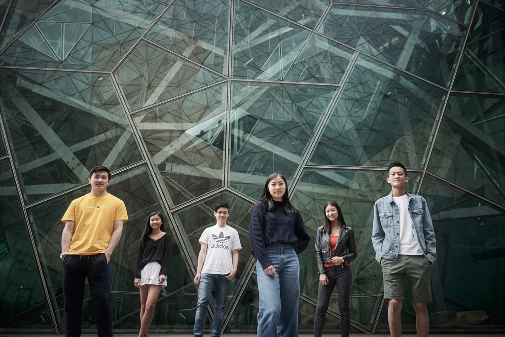 "Six of the nine co-founders of ""subtle asian traits"" with ages ranging from 17 to 21. Photo courtesy of The New York Times' Christina Simmons."