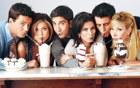 The six friends characters, Chandler (far left), Rachel, Ross, Monica, Joey, and Phoebe (far right) in this iconic photo of them enjoying sundaes.