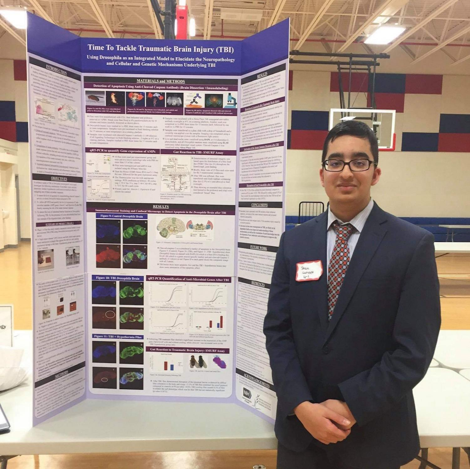 Sophomore Shan Lateef poses in front of his board at this year's Jefferson Science Fair