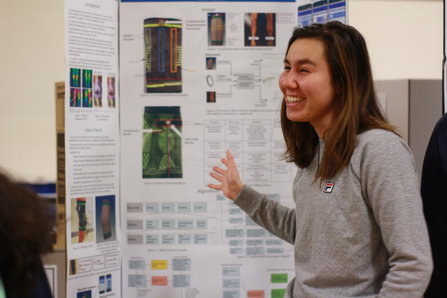 After+learning+that+her+project+was+a+Regeneron+semifinalist%2C+senior+Rachel+Naidich+passionately+discusses+her+project+with+visitors+of+the+Science+Fair.