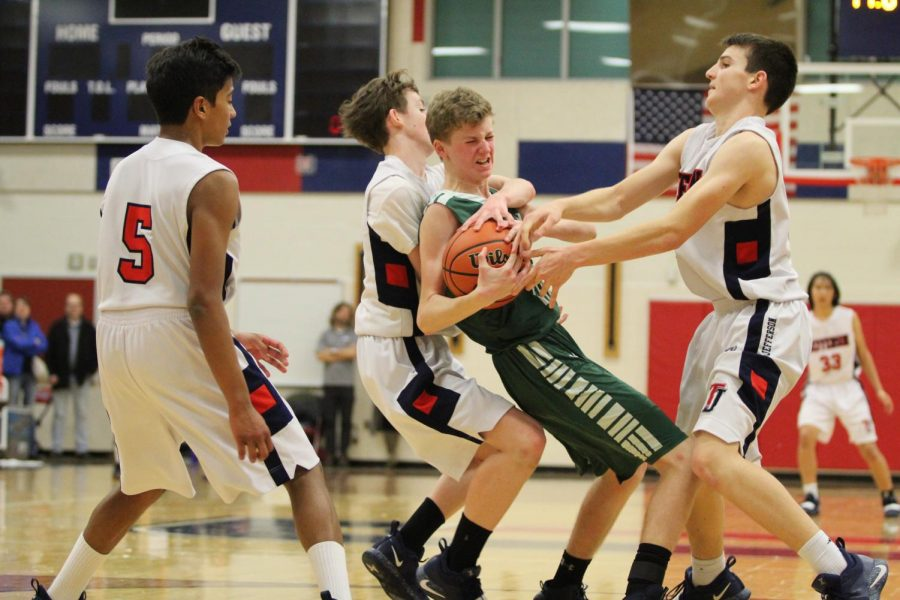 Boys varsity basketball team loses to Falls Church but triumphs in spirit: Photo highlights