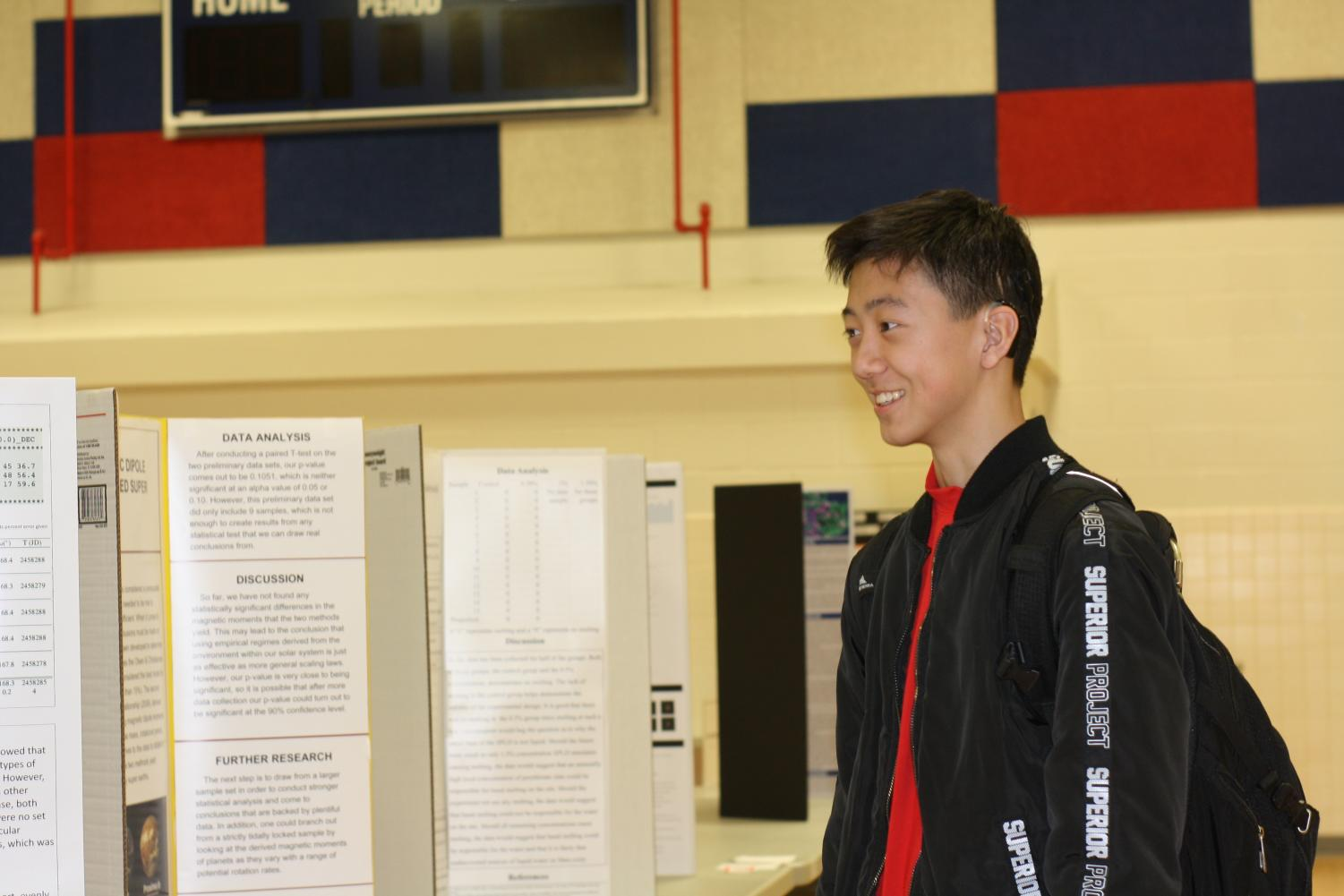 From+the+diagrams+and+data+analyses+to+the+discussions%2C+sophomore+Henry+Zhang+thoroughly+enjoys+the+projects+presented+at+the+fair.