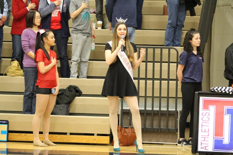 Singing+the+National+Anthem%2C+senior+Chrissy+Blake%27s+performances+marks+the+start+of+the+Men%E2%80%99s+Varsity+Basketball+game+against+Falls+Church+High+School.+Blake+has+participated+in+musical+theater+for+most+of+her+life.+%E2%80%9CI+practiced+a+bunch+and+did+some+vocal+warm+ups+beforehand.+I+was+pretty+nervous+so+I+was+really+just+hoping+I+wouldn%27t+accidentally+forget+any+of+the+words.%E2%80%9D