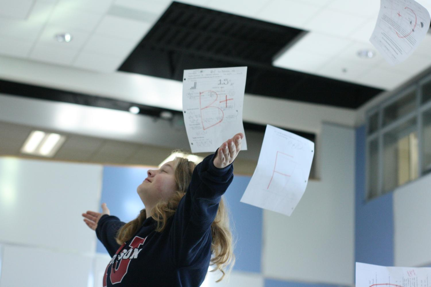 Freshman, Claire Wilson stands in Nobel Commons as she is showered with graded papers. Grades are an integral part of student life at Jefferson, but sometimes they don't always go our way (as seen in the picture). In those cases, is it alright to ask for a grade bump?
