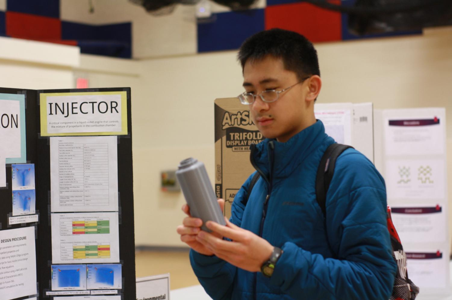 While+walking+around+the+fair%2C+sophomore+Derek+Goh+observes+props+put+on+display+with+projects.