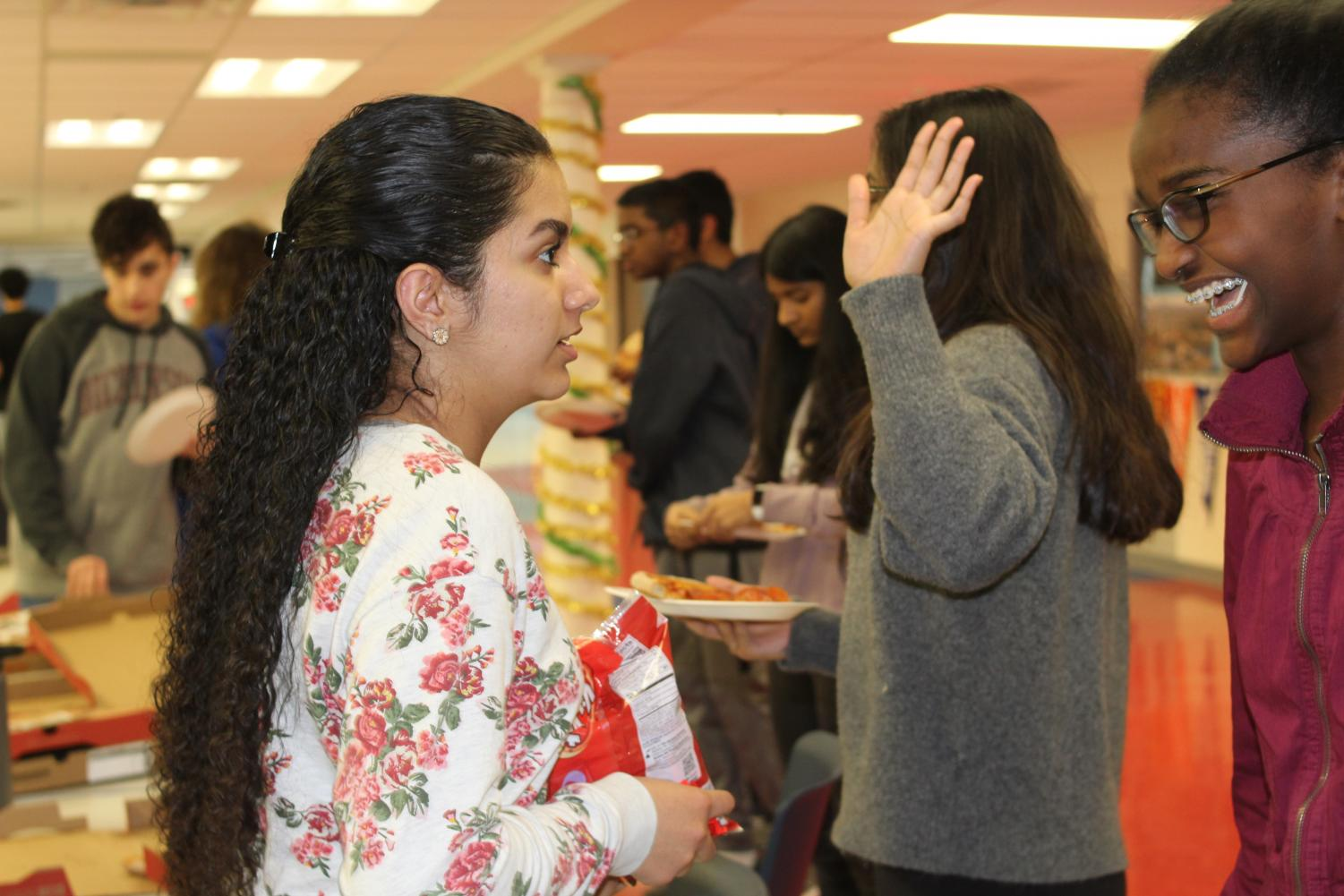After+the+passing+out+of+pizza%2C+two+of+the+organizers+of+the+Kindness+Extravaganza%2C+sophomores+Gurleen+Kaur+and+Eban+Ebssa+discuss+the+event.+%22I+thought+the+kindness+extravaganza+would+be+a+good+opportunity+for+people+to+perform+and+receive+kind+acts%2C+which+both+make+you+feel+good%2C+and+also+to+make+new+friends%2C%22+Ebssa+said.