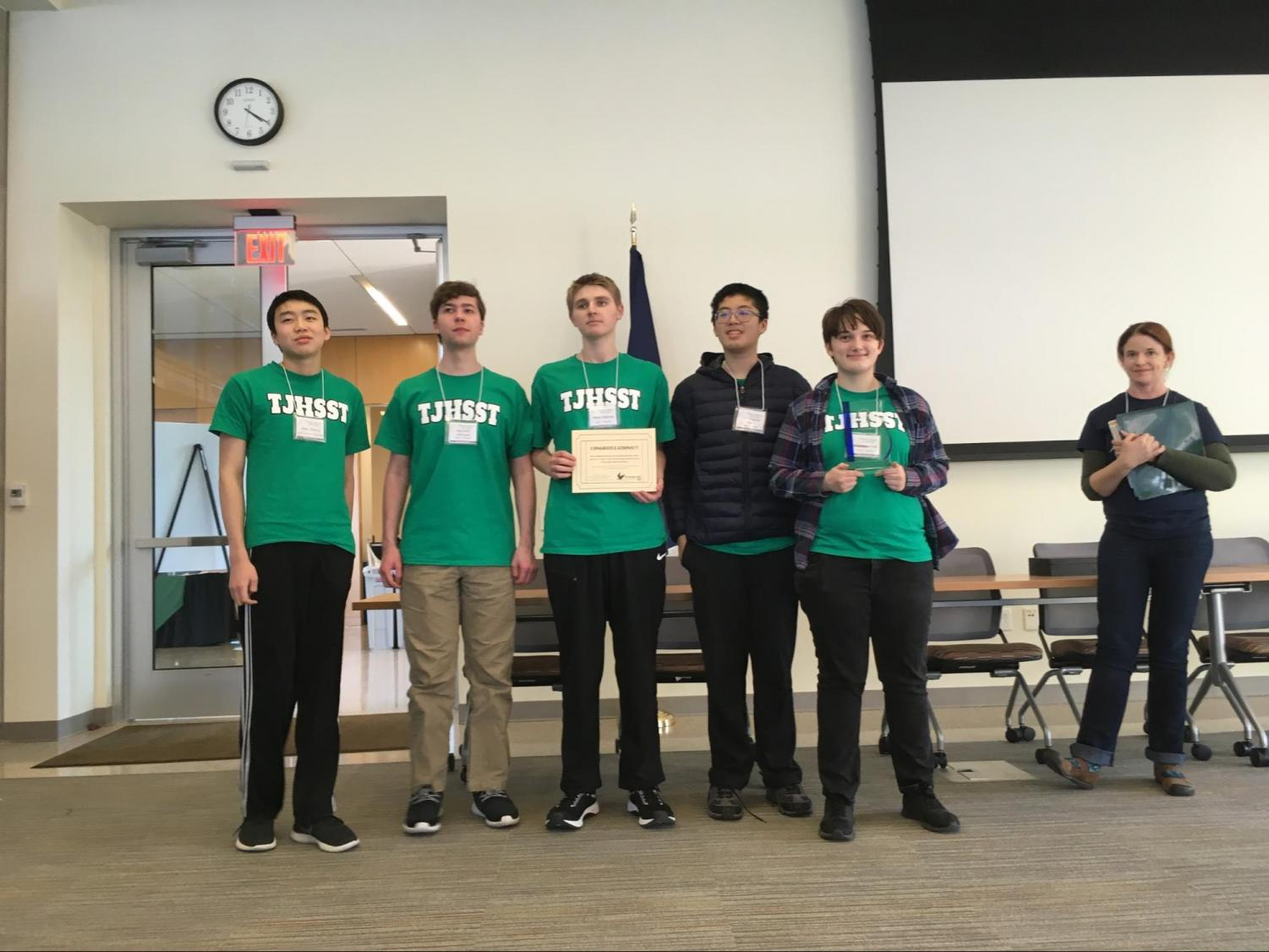 (From left to right: sophomore Alex Zhang, junior Kenny Johnson, senior Mark Putman, sophomore Chris Kan, senior MJ Old) Jefferson's Ocean Bowl A Team stands with their certificate and trophy for the Chesapeake Bay Bowl, a first for the club in five years.