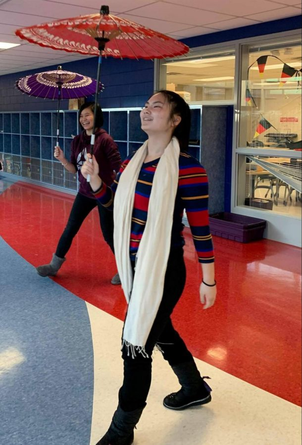Junior Zhejia Yang, front, and Senior Cynthia Zhang, back, twirl their yosakoi umbrellas while practicing for their onstage performance.