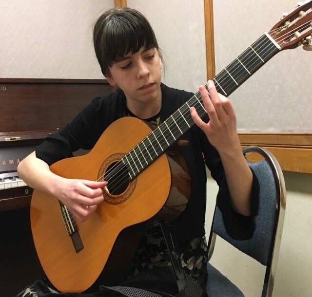 Freshman Elizabeth Brown avidly practices classical guitar. Many students at Jefferson have been involved with musical instruments, and guitar is no exception.