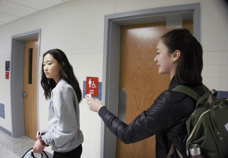 Sneaking up behind freshman Jeanie Qi, freshman Alyssa Rask attempts to