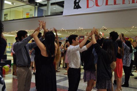 The members in SHS do a step in the dance where girl puts her hands up and the guy spins her around.