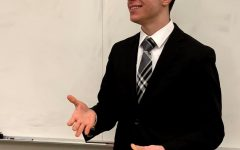 Jefferson's Congressional Debate captain, Dany Matar, smiles at his audience as he finishes his first speech in the 2018-2019 Metrofinals competition.