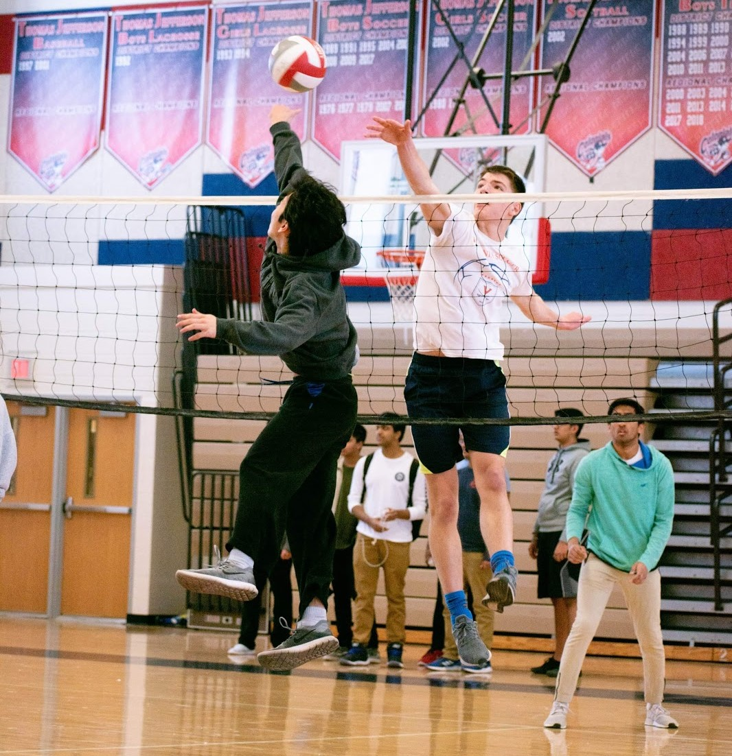 William Yao leaps up to return a serve during a high-intensity match of volleyball.