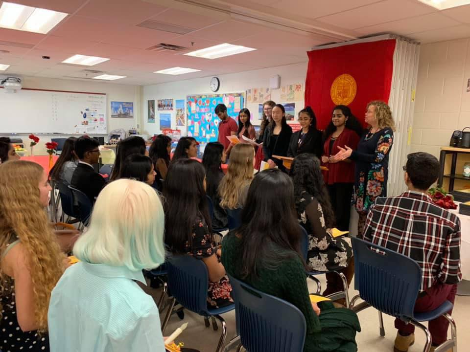 On March 6, the Spanish Honor Society of TJHSST welcomed the new members of their club during an induction ceremony. There, they sang Spanish songs, lit candles, and received plaques from Sra. Mateo and Sra. Gendive. Photo courtesy of Connie Ryu.