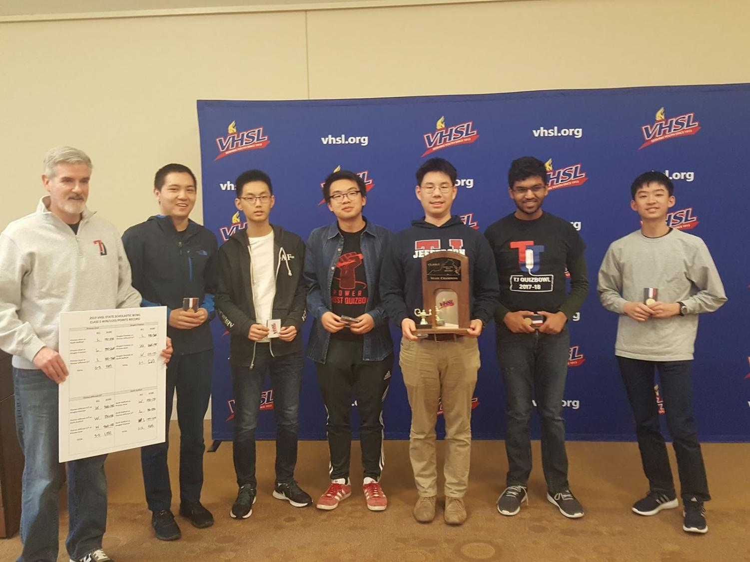 From left to right: club sponsor John Laffey, captain Fred Zhang, James Kuang, Ben Xu, William Wang, Prithvi Nathan, and Joshua Liang. Jefferson's Scholastic Bowl Team stands with their trophy and medals.