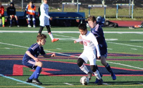 Dribbling down the field as two Woodson defenders attempt to steal the ball, midfielder Jason Zhong looks to pass the ball. Off to a slow start, the Colonials found themselves down by a goal in the first half but managed to hustle and clinch a 2-1 victory.