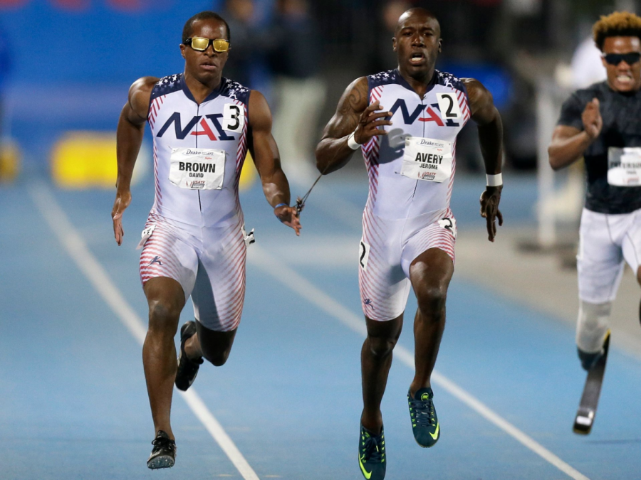 Visually impaired runner David Brown (left) and guide Jerome Avery compete in 2015 Paralympics. Photo courtesy of creative commons.