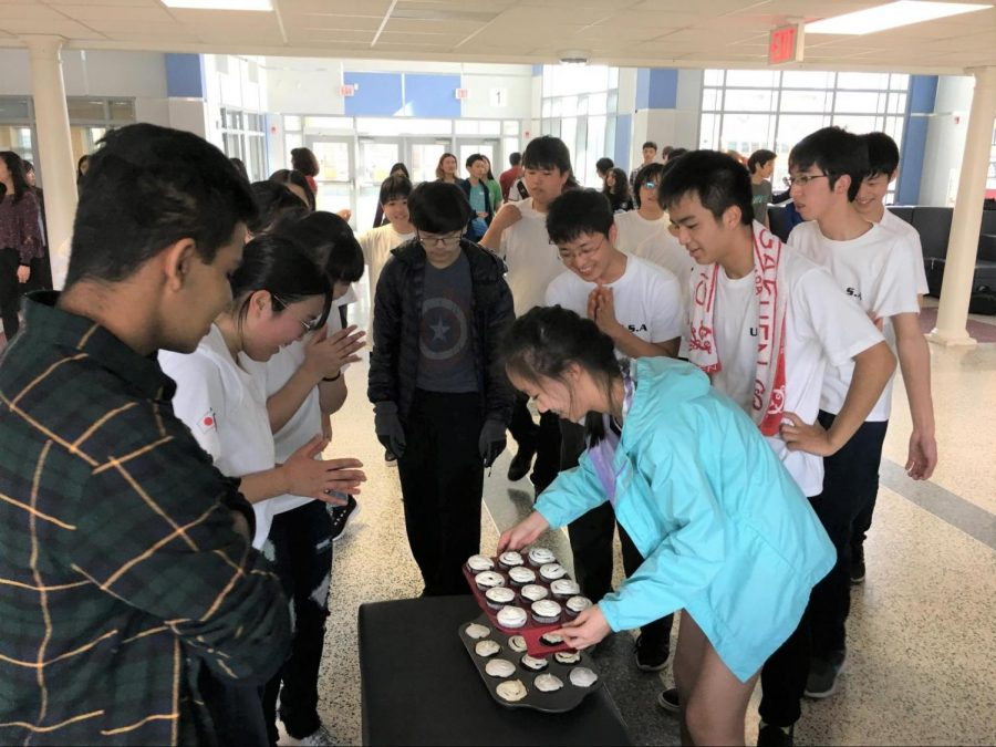 Sophomore Zia Sun unveils the cupcakes she baked for the Chiben students as they watch in surprise after the final performance.