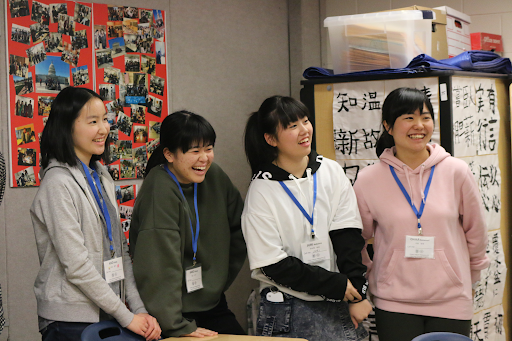 Chiben students Aiko Kouda, Kako Okada, Juri Nakaima, and Chika Nakamori laugh in delight as their teacher introduces himself.