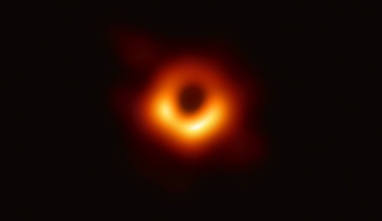 Image courtesy of www.NASA.gov.  Astronomers take the first picture of a black hole - although since even light escapes a black hole, the image depicts its shadow.