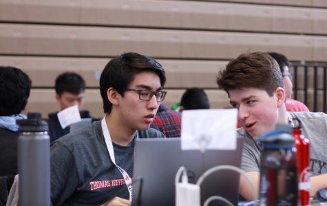 Juniors Daniel Li and David Mead discuss their project while coding at HackTJ. Due to effective planning from the HackTJ team, students like Li and Mead were able to participate in and enjoy this event.