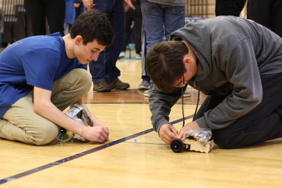 Felix+Cherkasskiy+and+Matthew+Lucio+set+up+their+robots+for+the+torque+competition+to+see+who+moves+on+to+the+next+bracket.+