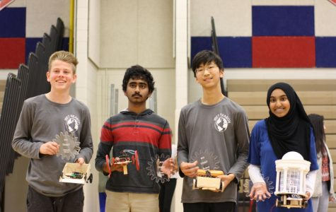 Freshmen Ryan Angle, Junho Lee, Akshan Sameullah, and Isra Satiar pose with their trophies and robots. They won the maze, torque, speed, and beauty competitions.