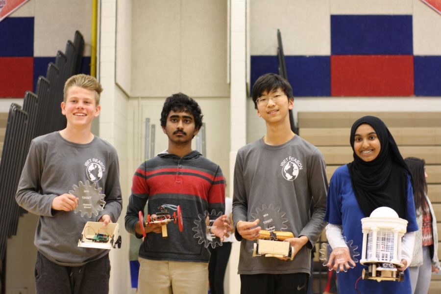 Freshmen+Ryan+Angle%2C+Junho+Lee%2C+Akshan+Sameullah%2C+and+Isra+Satiar+pose+with+their+trophies+and+robots.+They+won+the+maze%2C+torque%2C+speed%2C+and+beauty+competitions.+