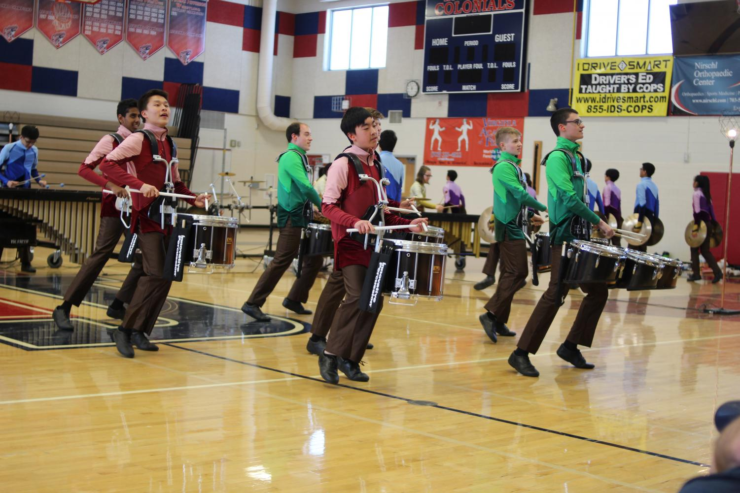 A+group+of+percussionists+move+from+side+to+side+while+tapping+quickly+on+their+instruments.+%E2%80%9CEarly+on+in+the+season%2C+we+were+learning+playing+basics+marching+basics+and+we+began+to+learn+the+music+for+the+show%2C%E2%80%9D+freshman+Chiraag+Govind+said.+%E2%80%9C+We+essentially+practiced+everyone+moving+from+one+dot+on+a+grid+to+another+on+certain+counts+until+we+had+all+of+the+basic+movement.%E2%80%9D%0A