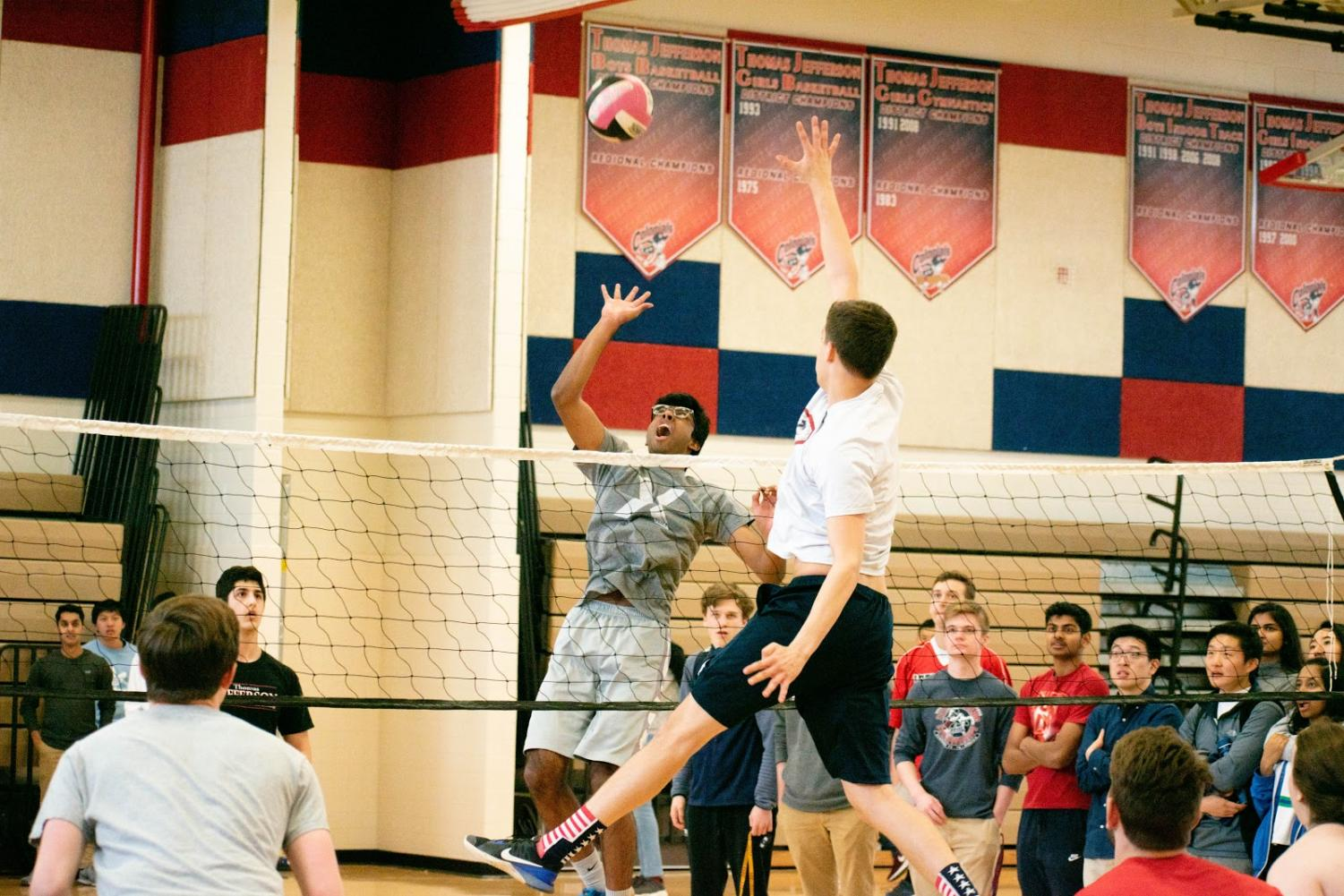 Senior Ankit Badatala reaches for a spike over senior Max Graves during the March Mania tournament. Photo courtesy of Forrest Meng.