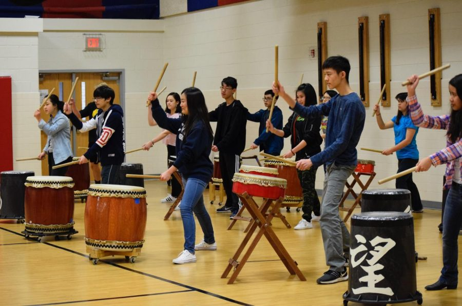Determined and concentrated at the task at hand, students under the guidance of taiko artist Mark H. Rooney prepare to strike the taiko drum. Students both interested in Japanese culture and involved with the Japanese program attended a workshop on Friday, March 22 to immerse themselves in the Japanese culture.