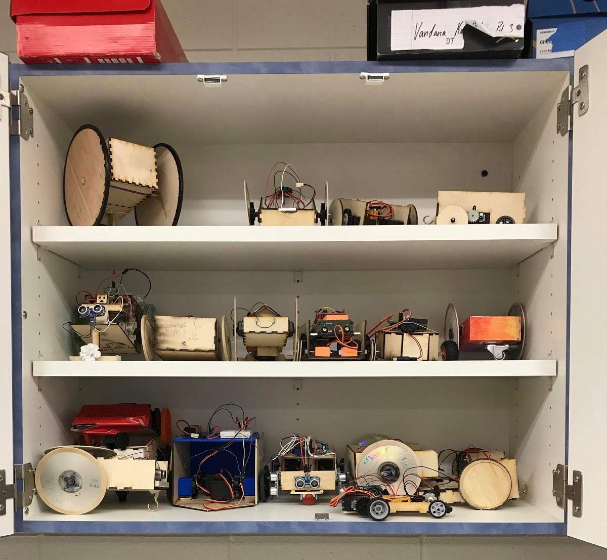 A shelf displays some of the robots built during the past two months. The annual robot project requires freshman to build a fully functioning robot and compete in a rigorous competition.