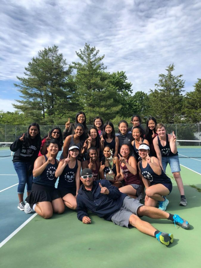 The+Jefferson+girls%27+tennis+team+poses+for+a+photo+after+their+victory+at+the+5C+regional+competition.+