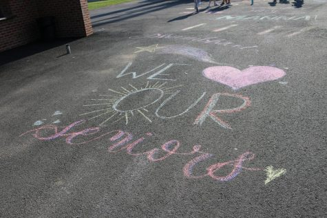 Before their game, the Jefferson varsity girls lacrosse team drew sidewalk art to commemorate senior night.