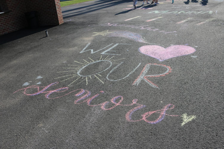 Before their game, the Jefferson varsity girls lacrosse team drew sidewalk art to commemorate senior night.
