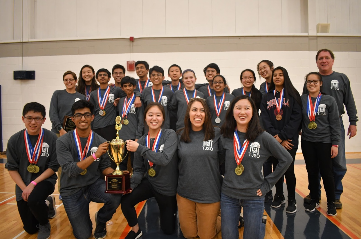 Photo courtesy of Thomas Jefferson Science Olympiad. Jefferson's Science Olympiad team, sponsored by Mrs. Holman, Ms. Mills, and Dr. Woodwell, proudly holds their trophy as the champions of the Virginia state tournament. Winning the state tournament, which was held at the University of Virginia on March 23rd, advances the team to nationals.