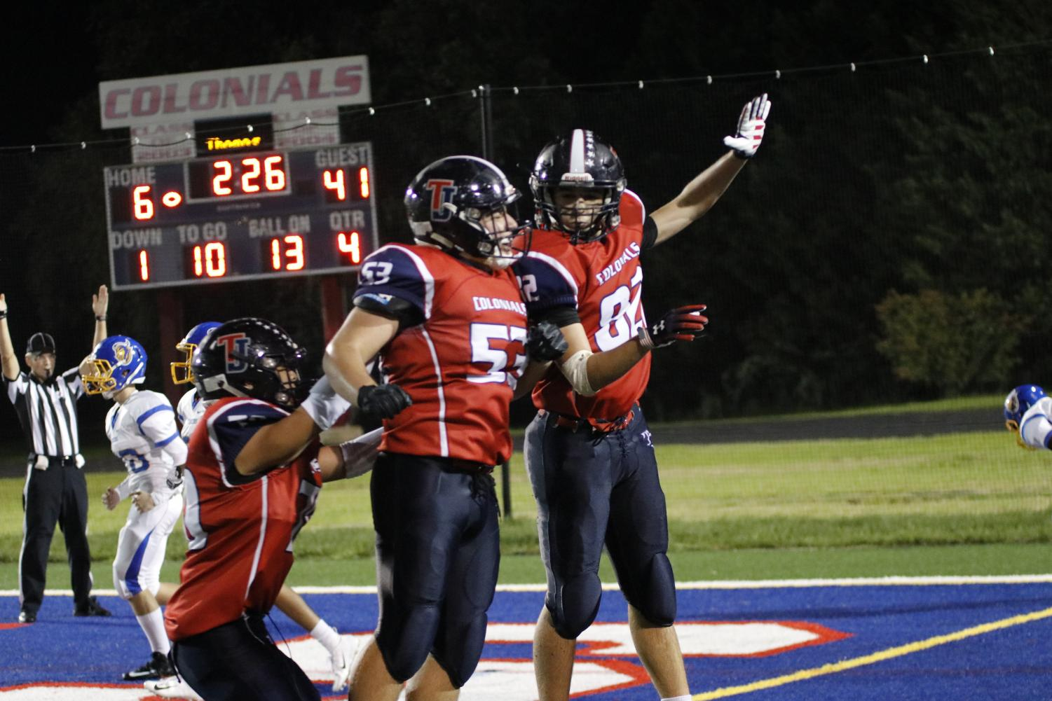 A group of Colonials celebrate after scoring a touchdown during last September's Back to School Bash game