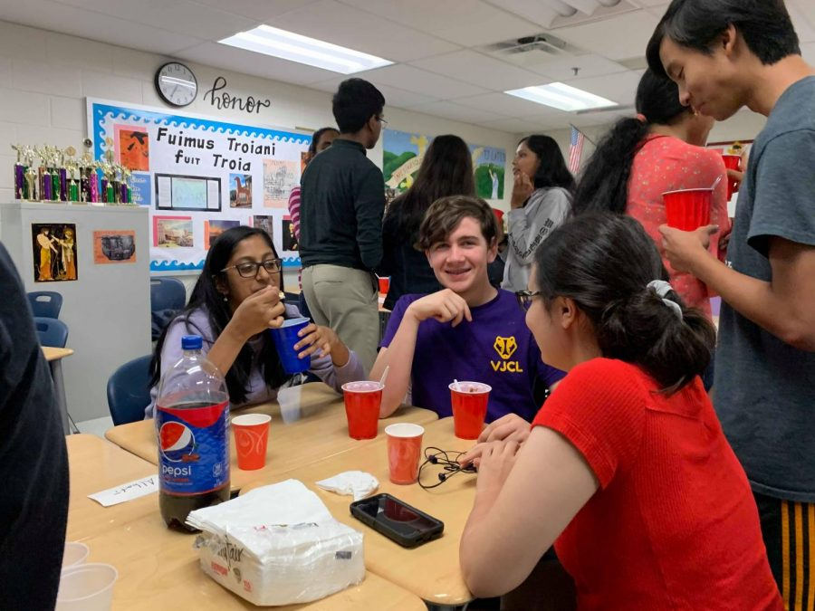 Students enjoy ice cream and the opportunity to socialize at the Latin ice cream social.