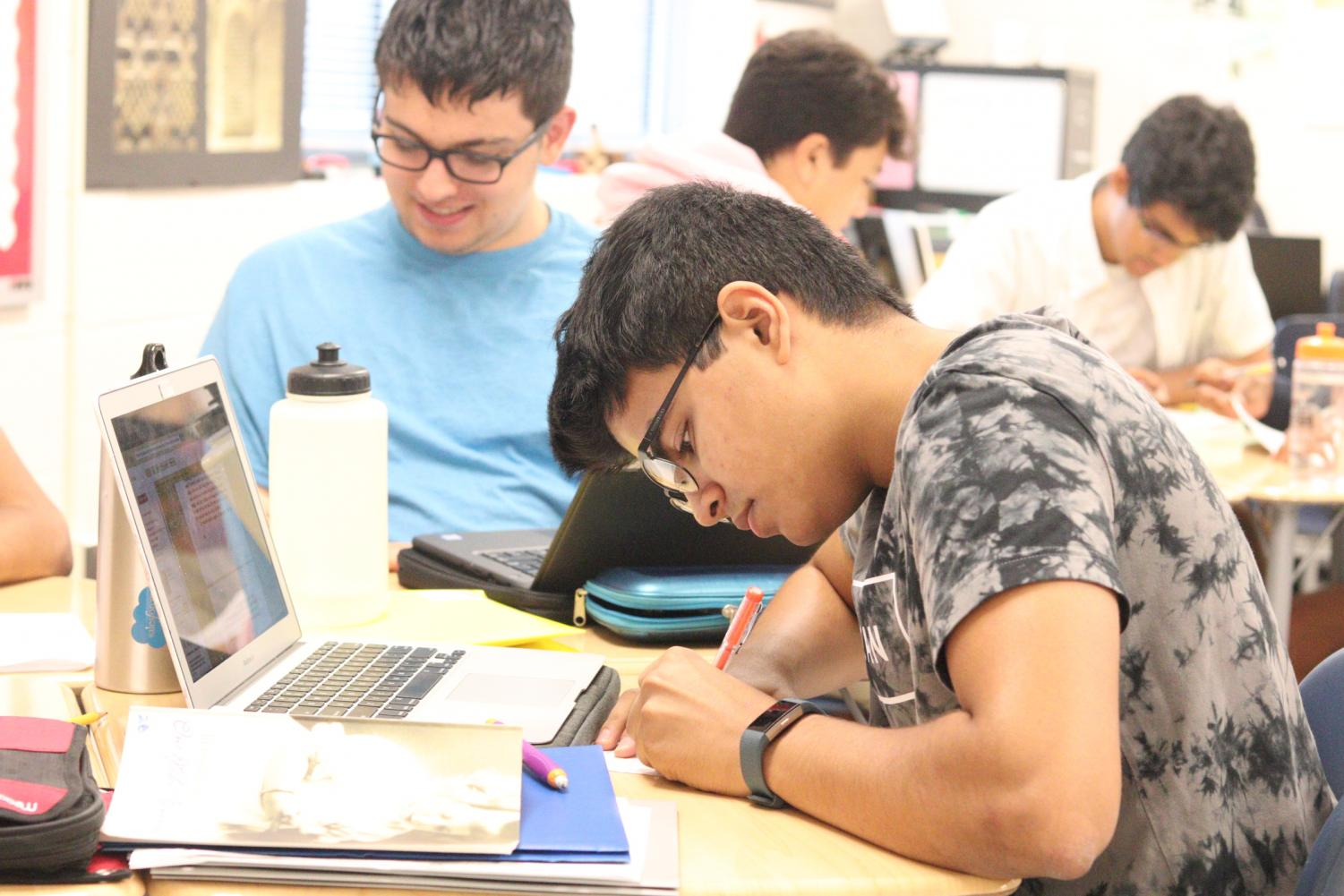 In a mixed grades BC class, a student works on his math classwork.