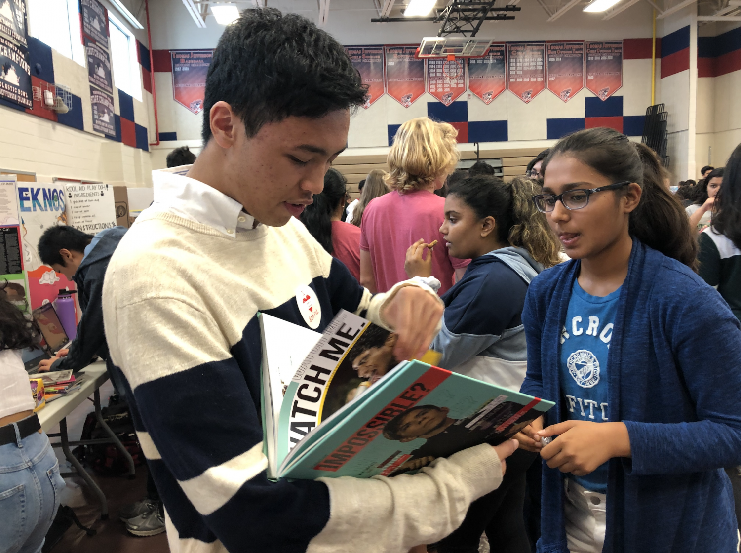 TJ Yearbook Co-Editor-in-Chief Steven Le speaks to freshman Niharika Chandna about joining TJ Media.  Le explains the formatting and student input involved with the publication of the 2018-19 yearbook.