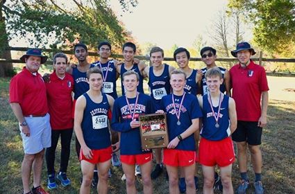 "The Varsity Boy's Cross-Country team poses for a photo. They placed first in districts against six other teams on Oct. 24. ""Because we did well at the meet we are moving on to the regional meet, and if we do well there, we will move to the state meet,"" Cross-Country captain Tucker Stanley said."
