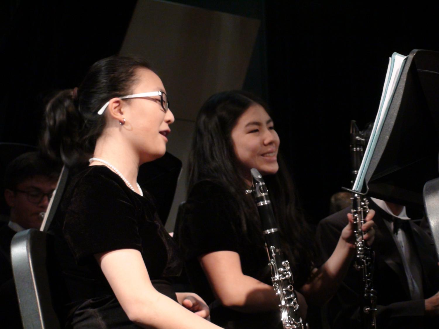 "Laughing with her friend, freshmen and clarinet player, Mira Kim, enjoys her first high school band concert as part of the Symphonic Wind Ensemble. She performed at the fall concert on Oct. 23 at Jefferson. ""Band is a significant part of how I handle my stress at TJ. I take band as a way to relax, rejuvenate, [and] just play music,"" Kim said."