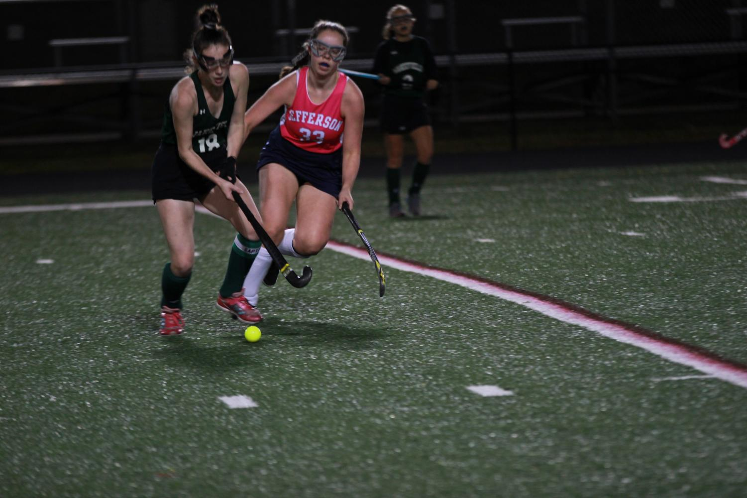 "Freshman Ellie Rowland attempts to take the ball from Wakefield. The first goal has been scored by Wakefield, but Jefferson was confident they could catch up. ""We weren't losing by that much so I thought we had it down, like we had an opportunity to win. So I think we were kind of optimistic,"" junior Arisa Chue said."
